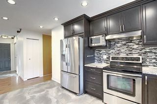 Photo 6: 9608 24 Street SW in Calgary: Palliser Detached for sale : MLS®# A1046388
