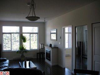 """Photo 1: 317 15388 101ST Avenue in Surrey: Guildford Condo for sale in """"ESCADA"""" (North Surrey)  : MLS®# F1008761"""