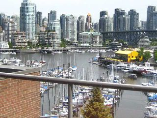 "Photo 1: 910 1450 PENNYFARTHING Drive in Vancouver: False Creek Condo for sale in ""HARBOUR COVE"" (Vancouver West)  : MLS®# V831435"
