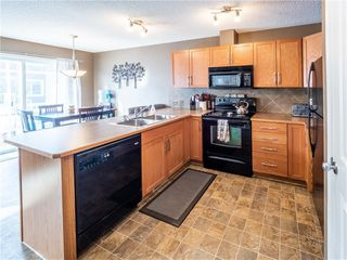 Photo 3: 1204 800 YANKEE VALLEY Boulevard SE: Airdrie Row/Townhouse for sale : MLS®# C4291708