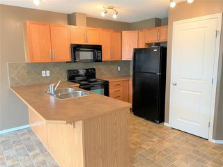 Photo 5: 1204 800 YANKEE VALLEY Boulevard SE: Airdrie Row/Townhouse for sale : MLS®# C4291708