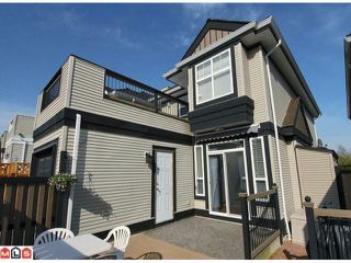 "Photo 10: 5723 148B Street in Surrey: Sullivan Station House for sale in ""Panorama Village"" : MLS®# F1010272"