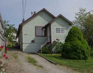 Photo 1: 1041 ALDERSON AV in Coquitlam: Maillardville House for sale : MLS®# V590261