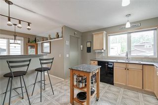 Photo 6: 13127 LAKE CRIMSON Drive SE in Calgary: Lake Bonavista Detached for sale : MLS®# C4305821