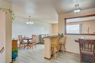 Photo 10: 716 HUNTS Crescent NW in Calgary: Huntington Hills Detached for sale : MLS®# C4299076