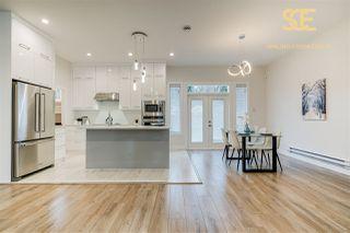 "Photo 2: 104 3499 GISLASON Avenue in Coquitlam: Burke Mountain Townhouse for sale in ""Smiling Creek Estate"" : MLS®# R2502414"
