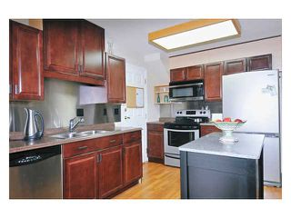 """Photo 3: 97 12099 237TH Street in Maple Ridge: East Central Townhouse for sale in """"THE GABRIOLA"""" : MLS®# V843157"""