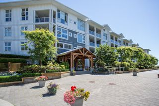 "Photo 1: 418 4600 WESTWATER Drive in Richmond: Steveston South Condo for sale in ""COPPER SKY"" : MLS®# R2423077"