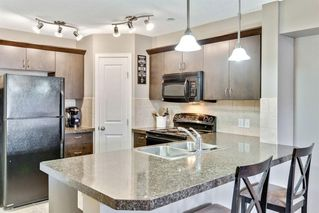 Photo 5: 1103 4 Kingsland Close SE: Airdrie Apartment for sale : MLS®# A1044769