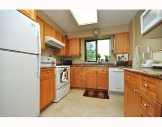 "Photo 4: 404 2445 W 3RD Avenue in Vancouver: Kitsilano Condo for sale in ""CARRIAGE HOUSE"" (Vancouver West)  : MLS®# V786416"