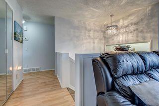 Photo 4: 14904 Deerfield Drive SE in Calgary: Deer Run Detached for sale : MLS®# A1053988
