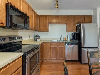 Photo 10: 133 Point Drive NW in Calgary: Point McKay Row/Townhouse for sale : MLS®# A1056926