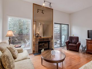 Photo 3: 133 Point Drive NW in Calgary: Point McKay Row/Townhouse for sale : MLS®# A1056926