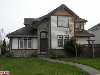 "Photo 1: 7390 145A Street in Surrey: East Newton House for sale in ""CHIMNEY HEIGHTS"" : MLS®# F1020858"