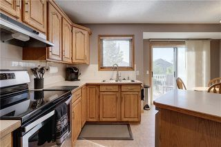 Photo 6: 66 TUSCANY HILLS Road NW in Calgary: Tuscany Detached for sale : MLS®# C4301652