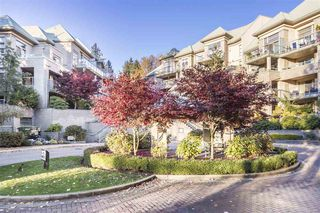 "Photo 1: 214A 301 MAUDE Road in Port Moody: North Shore Pt Moody Condo for sale in ""Heritage Grand"" : MLS®# R2466859"