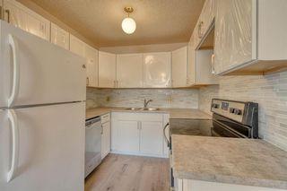 Photo 4: 3738 CEDARILLE Drive SW in Calgary: Cedarbrae Semi Detached for sale : MLS®# A1037615