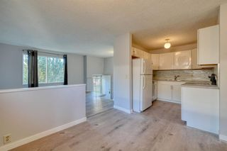 Photo 2: 3738 CEDARILLE Drive SW in Calgary: Cedarbrae Semi Detached for sale : MLS®# A1037615
