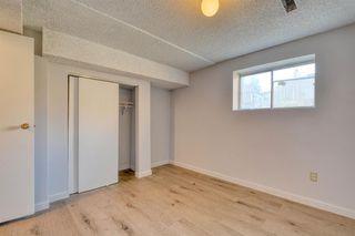 Photo 22: 3738 CEDARILLE Drive SW in Calgary: Cedarbrae Semi Detached for sale : MLS®# A1037615