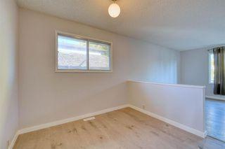 Photo 3: 3738 CEDARILLE Drive SW in Calgary: Cedarbrae Semi Detached for sale : MLS®# A1037615