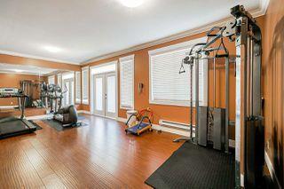 "Photo 19: 62 7156 144 Street in Surrey: East Newton Townhouse for sale in ""ZAAN"" : MLS®# R2412290"