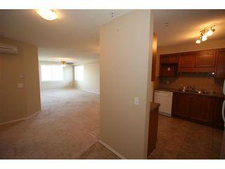 Photo 4: 2212 200 COMMUNITY Way: Okotoks Condo for sale : MLS®# C3434173