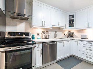 "Main Photo: 206 1420 E 8TH Avenue in Vancouver: Grandview Woodland Condo for sale in ""WILLOW BRIDGE"" (Vancouver East)  : MLS®# R2430101"