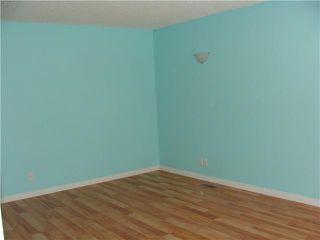 Photo 2: 30 ERIN RIDGE Place SE in CALGARY: Erinwoods Residential Detached Single Family for sale (Calgary)  : MLS®# C3602698
