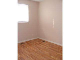 Photo 11: 30 ERIN RIDGE Place SE in CALGARY: Erinwoods Residential Detached Single Family for sale (Calgary)  : MLS®# C3602698