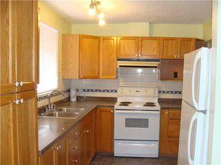 Photo 4: 30 ERIN RIDGE Place SE in CALGARY: Erinwoods Residential Detached Single Family for sale (Calgary)  : MLS®# C3602698