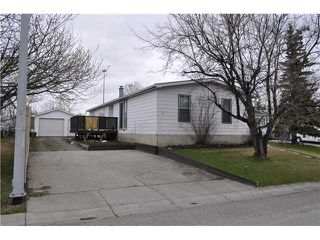 Photo 1: 52 SPRING HAVEN Road SE: Airdrie Double Wide for sale : MLS®# C3608403