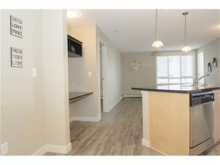 Photo 5: 206 120 COUNTRY VILLAGE Circle NE in Calgary: Country Hills Village Condo for sale : MLS®# C4028039