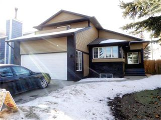 Photo 1: 13903 DEER RUN Boulevard SE in Calgary: Deer Run House for sale : MLS®# C4048969