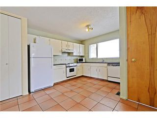 Photo 7: 6628 LETHBRIDGE Crescent SW in Calgary: Lakeview House for sale : MLS®# C4055225