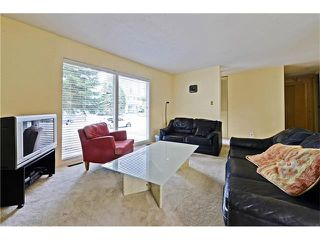 Photo 4: 6628 LETHBRIDGE Crescent SW in Calgary: Lakeview House for sale : MLS®# C4055225