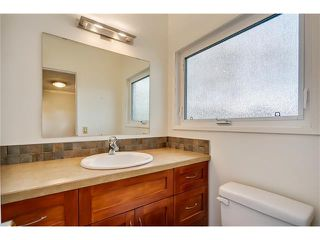 Photo 12: 5623 LODGE Crescent SW in Calgary: Lakeview House for sale : MLS®# C4117298