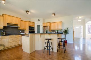 Photo 10: 152 STRATHLEA Place SW in Calgary: Strathcona Park House for sale : MLS®# C4130863