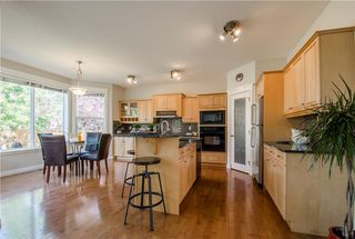 Photo 8: 152 STRATHLEA Place SW in Calgary: Strathcona Park House for sale : MLS®# C4130863
