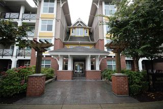 "Main Photo: 211 17712 57A Avenue in Surrey: Cloverdale BC Condo for sale in ""West on Village Walk"" (Cloverdale)  : MLS®# R2318149"