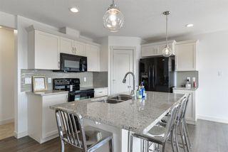 Photo 5: 1647 HAMMOND Crescent in Edmonton: Zone 58 House Half Duplex for sale : MLS®# E4150919