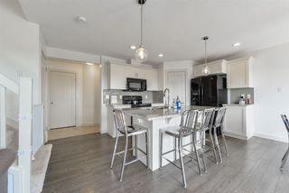 Photo 2: 1647 HAMMOND Crescent in Edmonton: Zone 58 House Half Duplex for sale : MLS®# E4150919