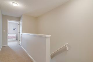 Photo 23: 235 ASCOT Circle SW in Calgary: Aspen Woods Row/Townhouse for sale : MLS®# A1025064