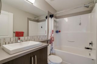 Photo 26: 235 ASCOT Circle SW in Calgary: Aspen Woods Row/Townhouse for sale : MLS®# A1025064