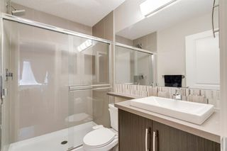Photo 30: 235 ASCOT Circle SW in Calgary: Aspen Woods Row/Townhouse for sale : MLS®# A1025064