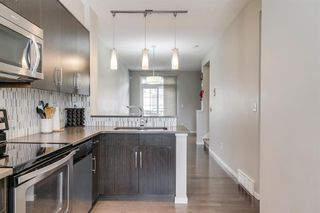 Photo 13: 235 ASCOT Circle SW in Calgary: Aspen Woods Row/Townhouse for sale : MLS®# A1025064