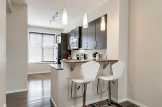 Photo 14: 235 ASCOT Circle SW in Calgary: Aspen Woods Row/Townhouse for sale : MLS®# A1025064