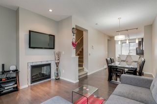 Photo 20: 235 ASCOT Circle SW in Calgary: Aspen Woods Row/Townhouse for sale : MLS®# A1025064