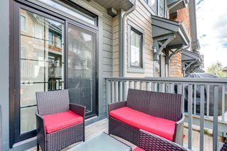 Photo 34: 235 ASCOT Circle SW in Calgary: Aspen Woods Row/Townhouse for sale : MLS®# A1025064