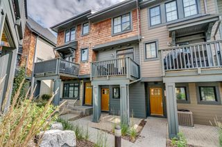 Photo 2: 235 ASCOT Circle SW in Calgary: Aspen Woods Row/Townhouse for sale : MLS®# A1025064