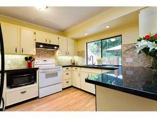 Photo 3: 14 DARNEY BAY Road in Port Moody: Barber Street House for sale : MLS®# V947390